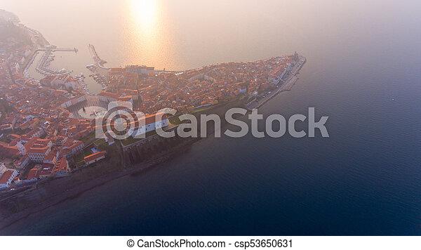 Aerial view of mediterranean coastal town at sunset. - csp53650631