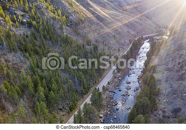 aerial view of mountain river at sunset - csp68465840