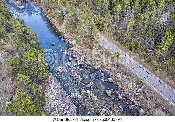 aerial view of mountain river at sunset - csp68465794