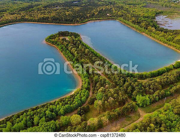 Aerial view of pond on a sunny summer day forest panorama - csp81372480