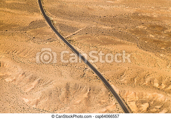 aerial view of road in grand canyon desert - csp64066557