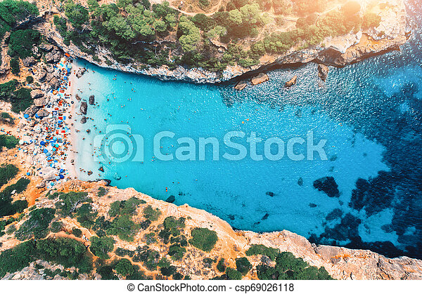 Aerial view of sandy beach with swimming people - csp69026118