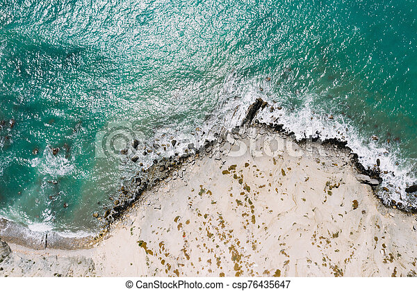 Aerial view of sea waves and rocky coast, Turkey. - csp76435647