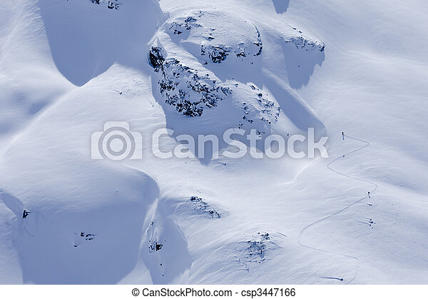 Aerial View of Skiers On a Mountaintop  - csp3447166