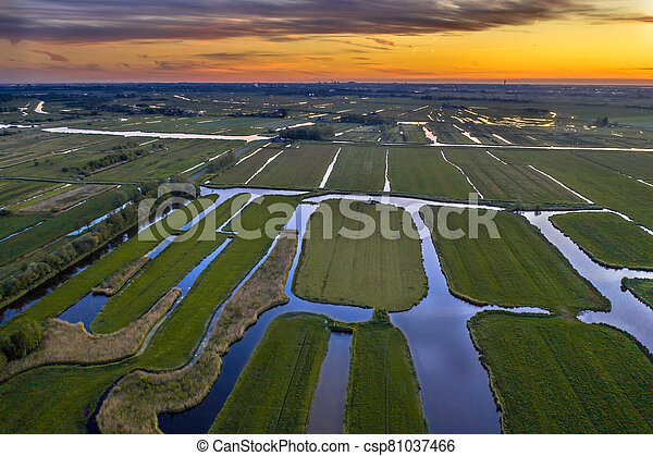 Aerial view of Sunset over Historic dutch Waterland - csp81037466