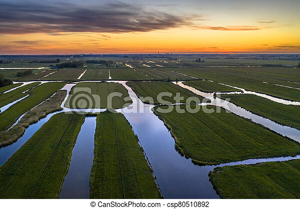 Aerial view of Sunset over Historic dutch Waterland - csp80510892