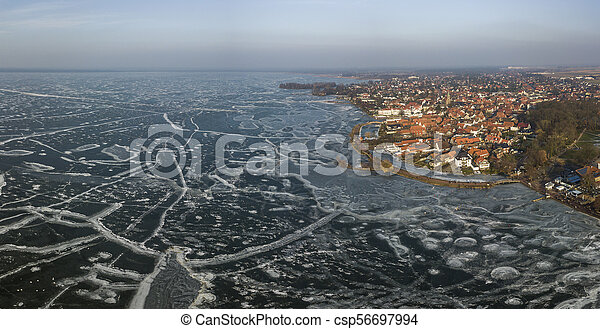 Aerial view of the frozen Steinhude lake in Lower Saxony - csp56697994
