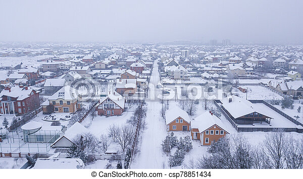 Aerial view of the snowy village in the afternoon - csp78851434