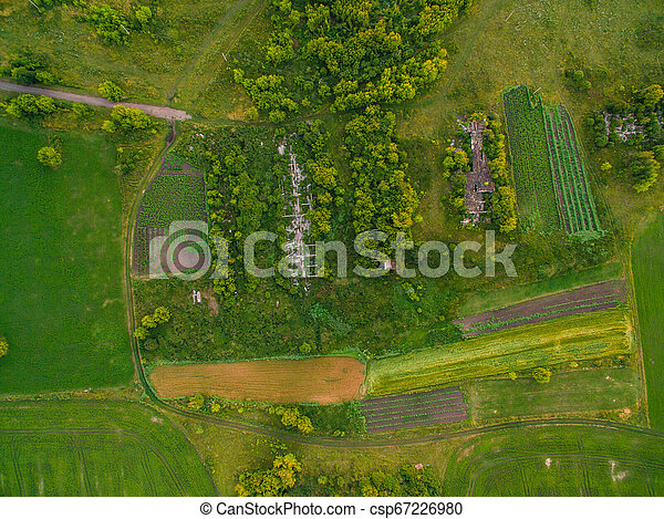 Aerial view of twisting road among the forest and trees. Sunset field in Lithuania - csp67226980