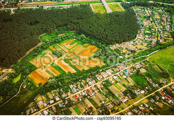 Aerial View Of Vegetable Gardens In Small Town Or Village. Skyline In Summer Evening. Village Garden Beds In Bird's-eye View - csp93095165