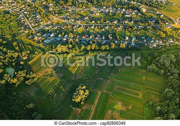 Aerial View Of Vegetable Gardens In Small Town Or Village. Skyline In Summer Evening. Village Garden Beds In Bird's-eye View - csp92806349