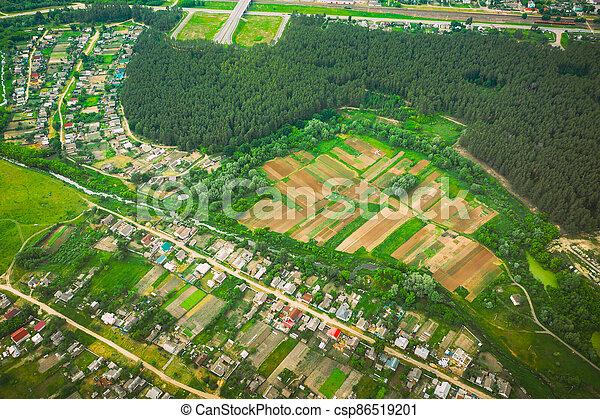 Aerial View Of Vegetable Gardens In Small Town Or Village. Skyline In Summer Evening. Village Garden Beds In Bird's-eye View - csp86519201