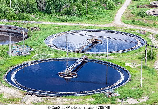 Aerial view of water treatment plant with round settlers - csp14785748