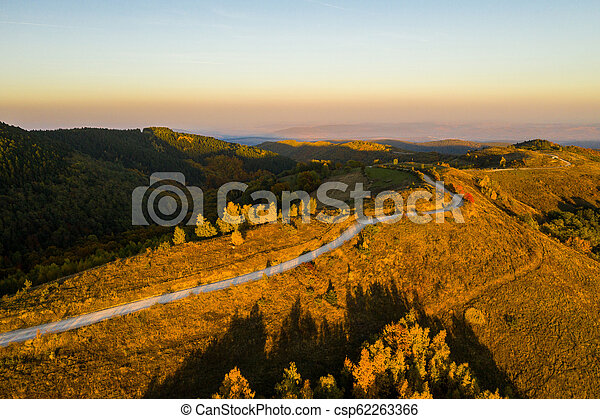 Aerial view of winding road at autumn - csp62263366