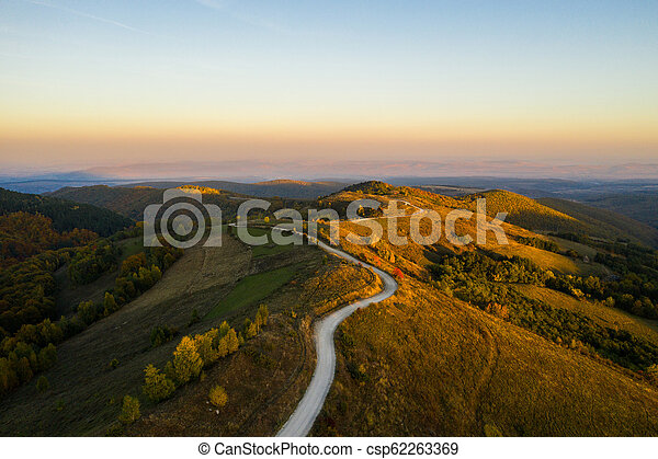 Aerial view of winding road at autumn - csp62263369