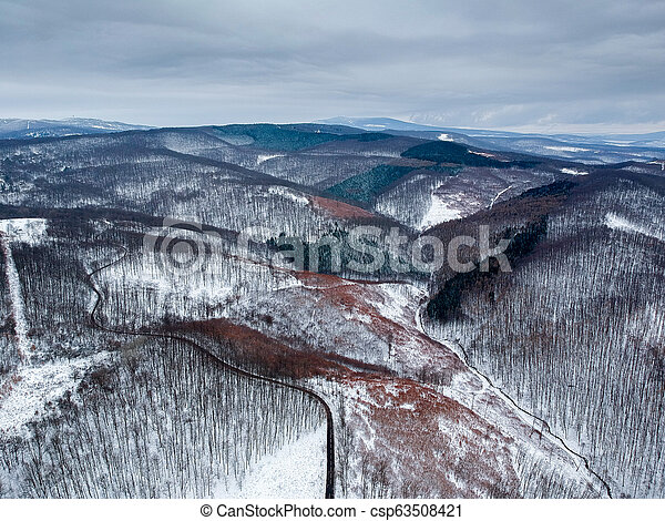 Aerial view of winding road in winter - csp63508421
