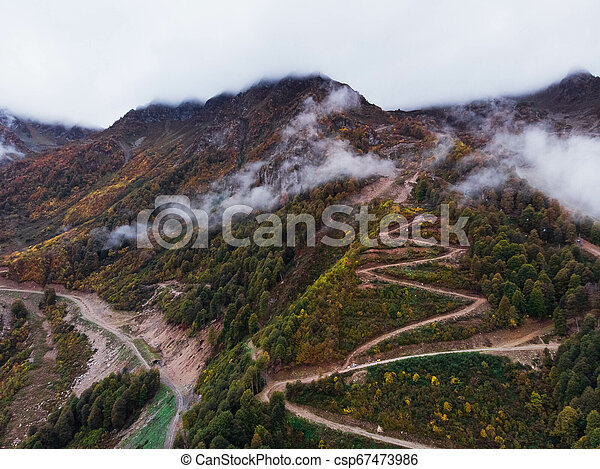 Aerial view of winding road - csp67473986