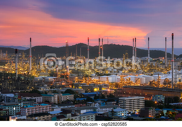 Aerial view Oil refinery with a background of mountains and sky. - csp52820585