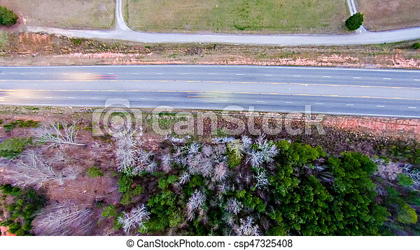 aerial view over country road forest and fields - csp47325408