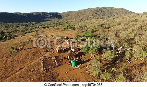 Aerial view over small african village - csp49704968
