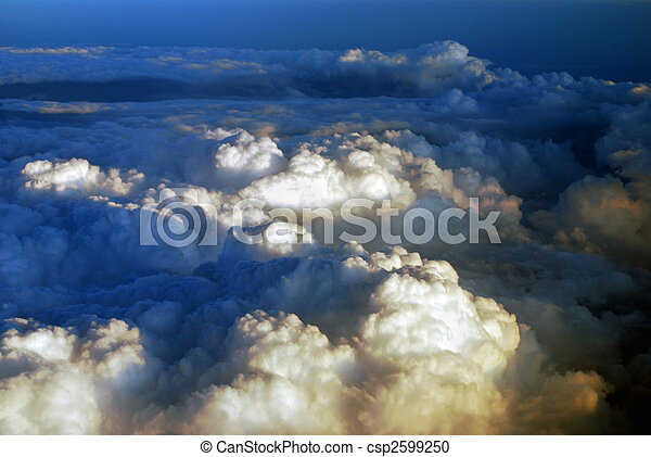 aerial view over the clouds at sunset - csp2599250