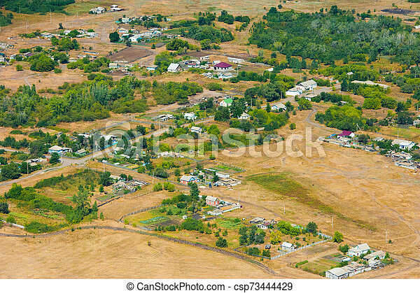 Aerial view over the small town - csp73444429