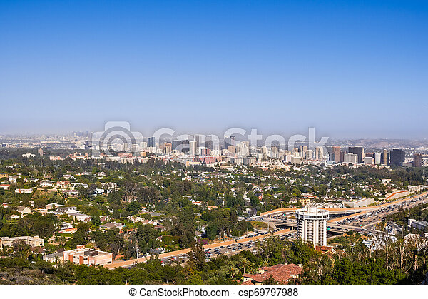 Aerial view towards the skyline of Century City commercial district; downtown area skyscrapers visible in the background; highway 405 and residential area in the foreground; Los Angeles, California - csp69797988