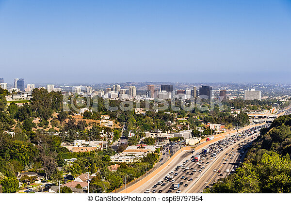 Aerial view towards the skyline of Westwood neighborhood; highway 405 with heavy traffic in the foreground; Los Angeles, California - csp69797954