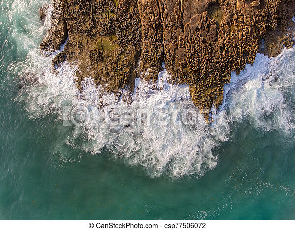 Aerial view, waves crash on a rocky shore. Portugal. - csp77506072