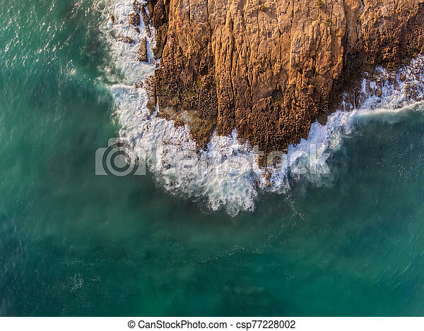 Aerial view, waves crash on a rocky shore. Portugal. - csp77228002