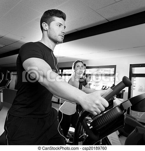 Aerobics elliptical walker trainer group at gym - csp20189760