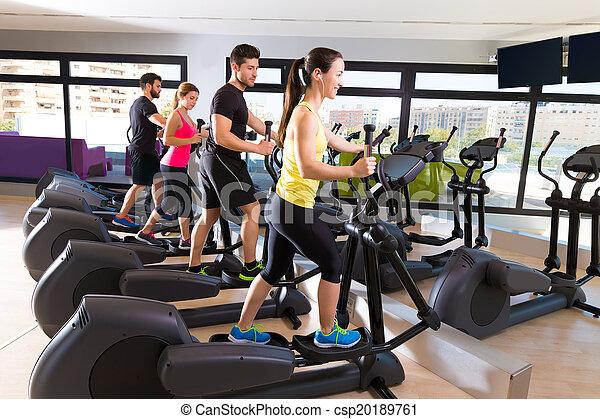 Aerobics elliptical walker trainer group at gym - csp20189761