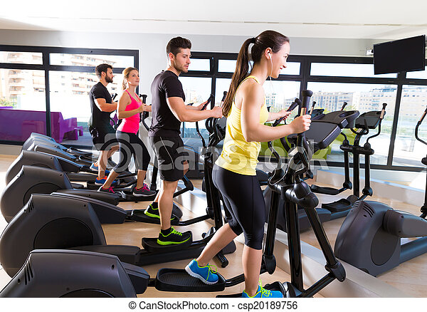Aerobics elliptical walker trainer group at gym - csp20189756