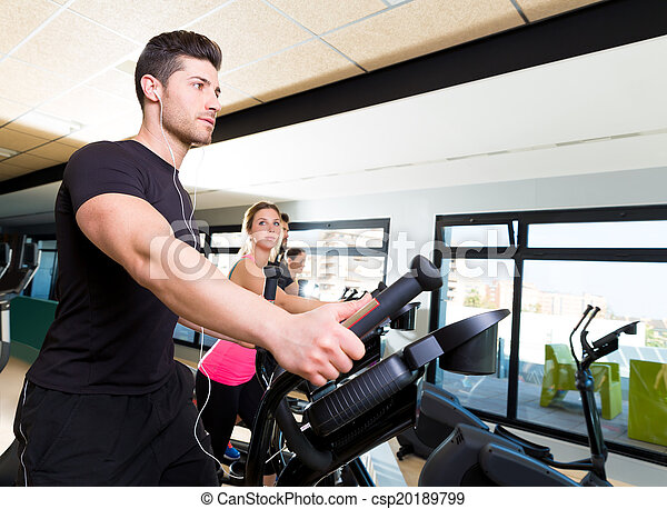 Aerobics elliptical walker trainer group at gym - csp20189799