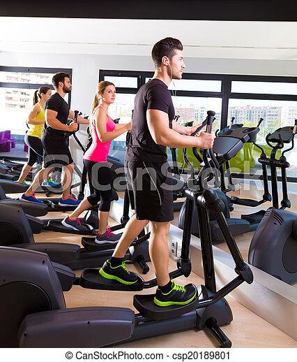 Aerobics elliptical walker trainer group at gym - csp20189801