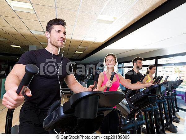 Aerobics elliptical walker trainer group at gym - csp20189803