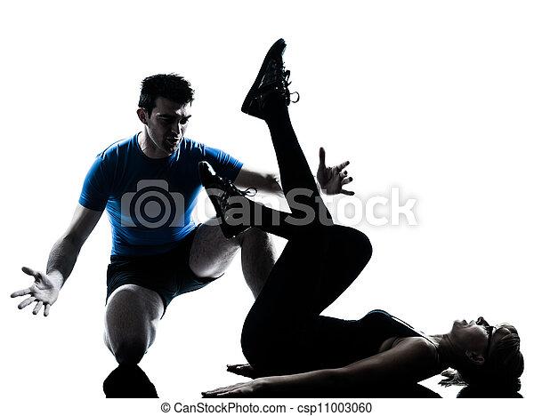 aerobics intstructor  with mature woman exercising - csp11003060