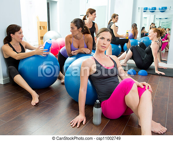 Aerobics pilates women group having a rest at gym - csp11002749