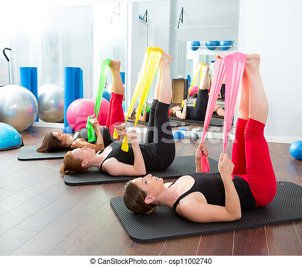 Aerobics pilates women with rubber bands in a row - csp11002740