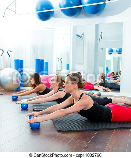 Aerobics pilates women with toning balls in a row - csp11002766