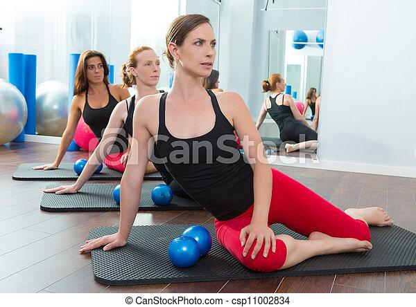 Aerobics pilates women with toning balls in a row - csp11002834