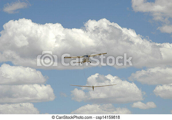 Aeroplane towing glider into the air - csp14159818
