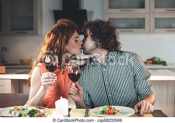 Affectionate man and woman having romantic dinner - csp58233569