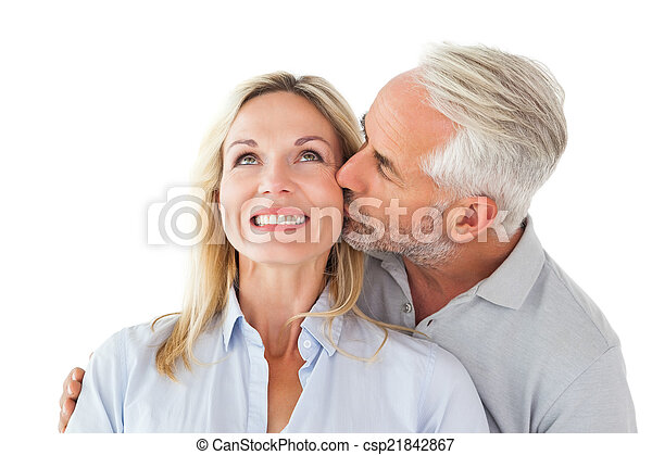 Affectionate man kissing his wife on the cheek  - csp21842867