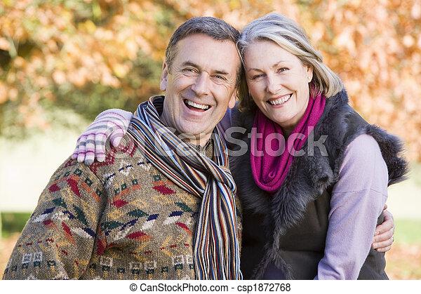 Affectionate senior couple on autumn walk - csp1872768