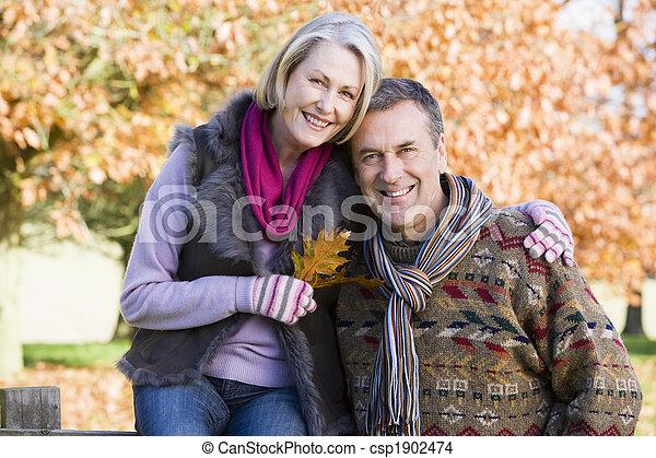 Affectionate senior couple on autumn walk - csp1902474