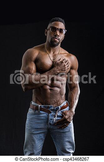 eecc812e00 African american bodybuilder man, muscular torso, wearing jeans ...