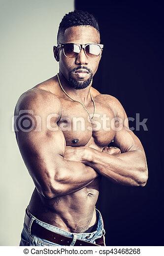 d1e650d110 African american bodybuilder man, muscular torso, wearing jeans, on ...