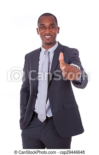 African american business man making thumbs up gesture over white background - Black people - csp29446648