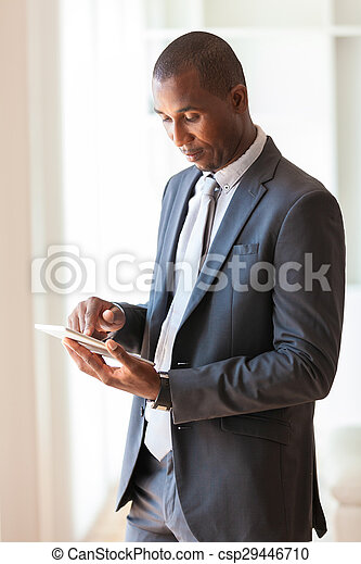 African american business man using a tactile tablet -Black people - csp29446710